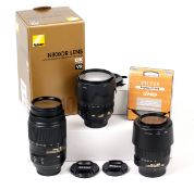 Three Nikon AF Vibration Reduction Zoom Lenses.