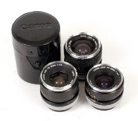 Three Canon FD Wide Angle Lenses.