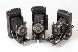 Three 120 Houghton's Ensign Autorange Cameras.