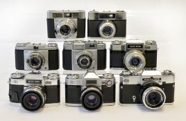 Eight Zeiss Ikon 35mm Cameras.