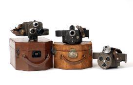 Three Bell & Howell Filmo Cine Cameras.
