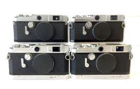 Four Canon Rangefinder Camera Bodies.