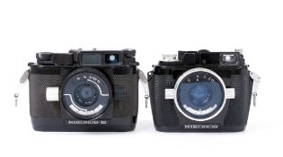 Two Nikonos Underwater Film Cameras.
