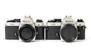 Pair of Chrome Nikon FM2 Camera Bodies.