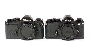Pair of Black Nikon FM Camera Bodies.