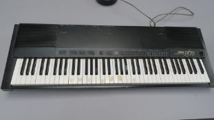 Yamaha vintage PF70 electronic piano circa 1980's made in Japan with user manual. Tested and in