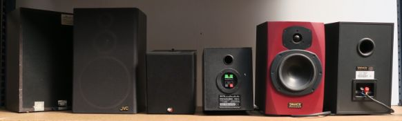 Three pairs of bookshelf speakers - JVC model SP, Wharfdale 30D6 and Tannoy Reveal in red (with