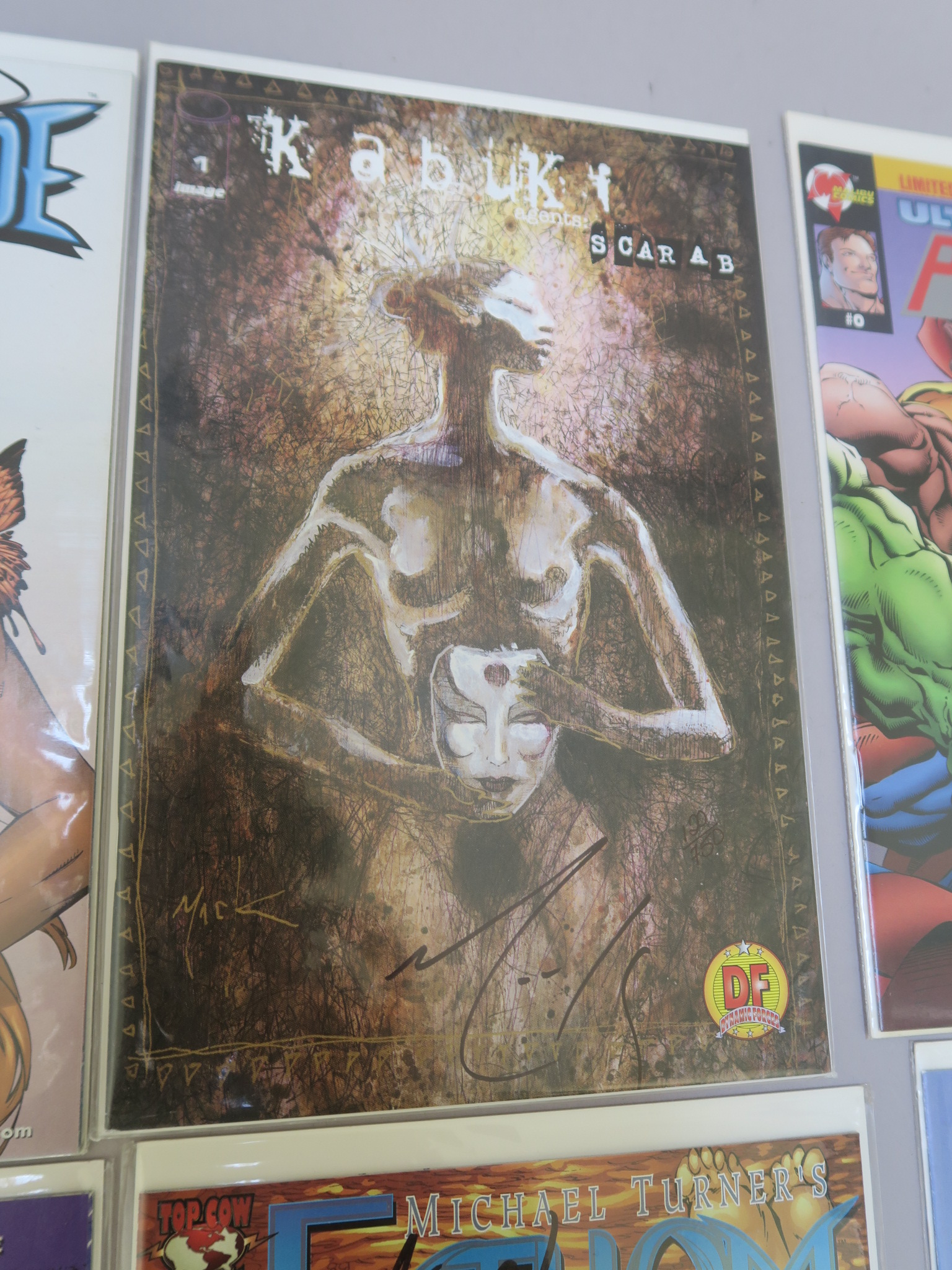 Lot 4 - 17 Signed comics including Cyberforce #25 (signed by Brian Holguin, David Finch, Anthony Chun and