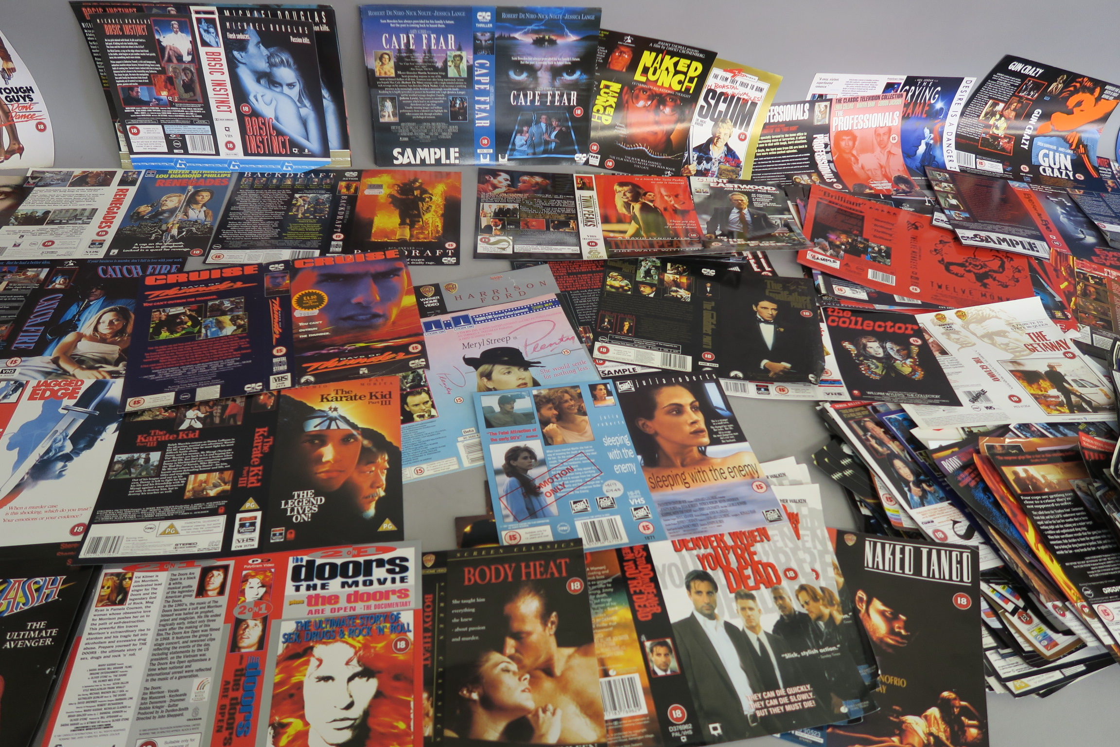 Lot 38 - Collection of thriller genre video sleeves from a closed video shop. Titles include True Romance,