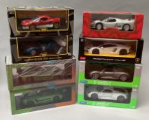 8 assorted 1/18 scale diecast model cars. All boxed.