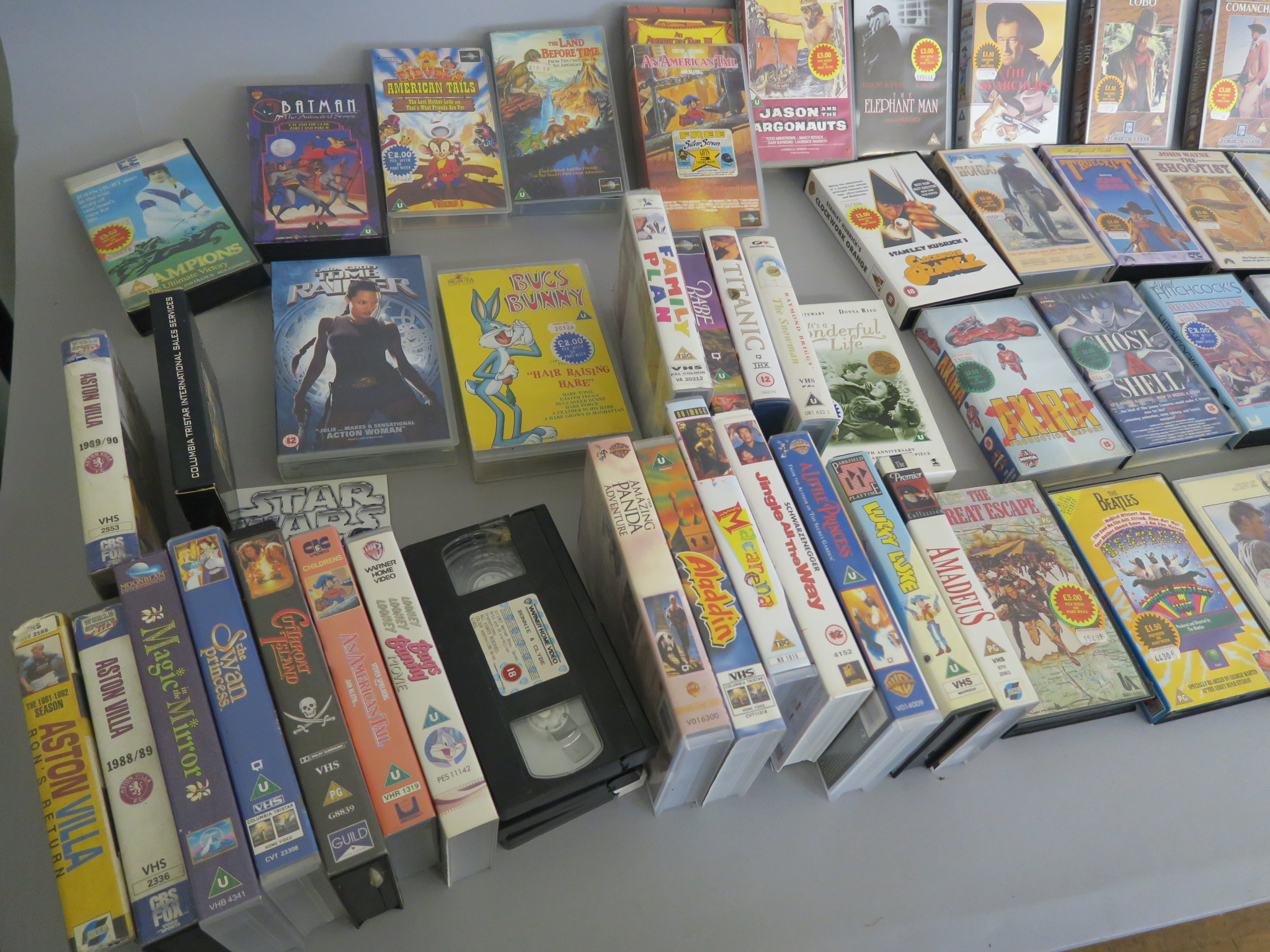 Lot 28 - Over 80 vhs ex-rental videos directly from a closed video shop and offered for sale for the first