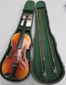 German Violin (refurbished) with hollow wood body and hand carved scroll in hardcase with green