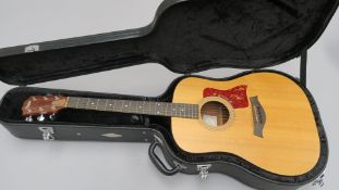 Taylor electro-acoustic guitar model 210 serial number 20040709202 with mahogany back and sides