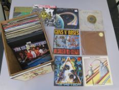 Two boxes of approximately 50+ LPs including Def Leppard ltd ed no 5006, Guns N Roses, Black