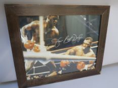 Buster Douglas autographed photo with Certificate of authenticity affixed to reverse, framed 20 x 24