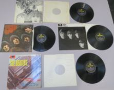 Beatles 4 LP records including Please Please Me Parlophone PMC 1202, With the Beatles PMC 1206,