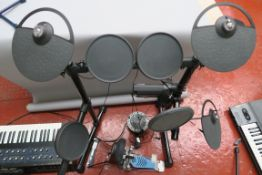 Yamaha Electronic DTX Drum kit with KP65 pedal drum, Audio Technica head phones and instruction