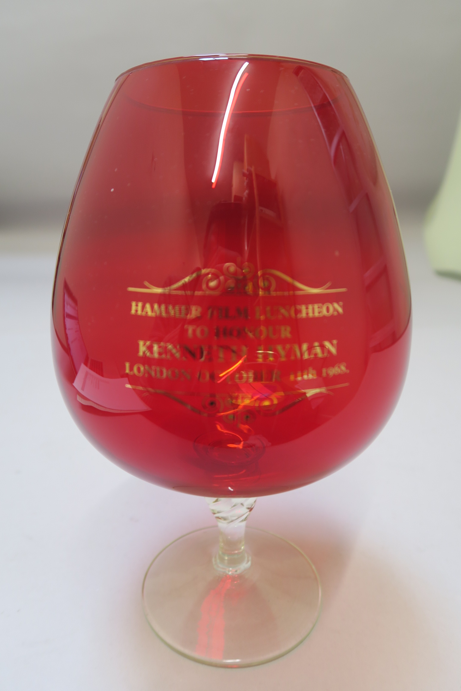 "Lot 34 - ""Hammer Film Luncheon to honour Kenneth Hyman London October 11th 1968"" Red glass vase with"