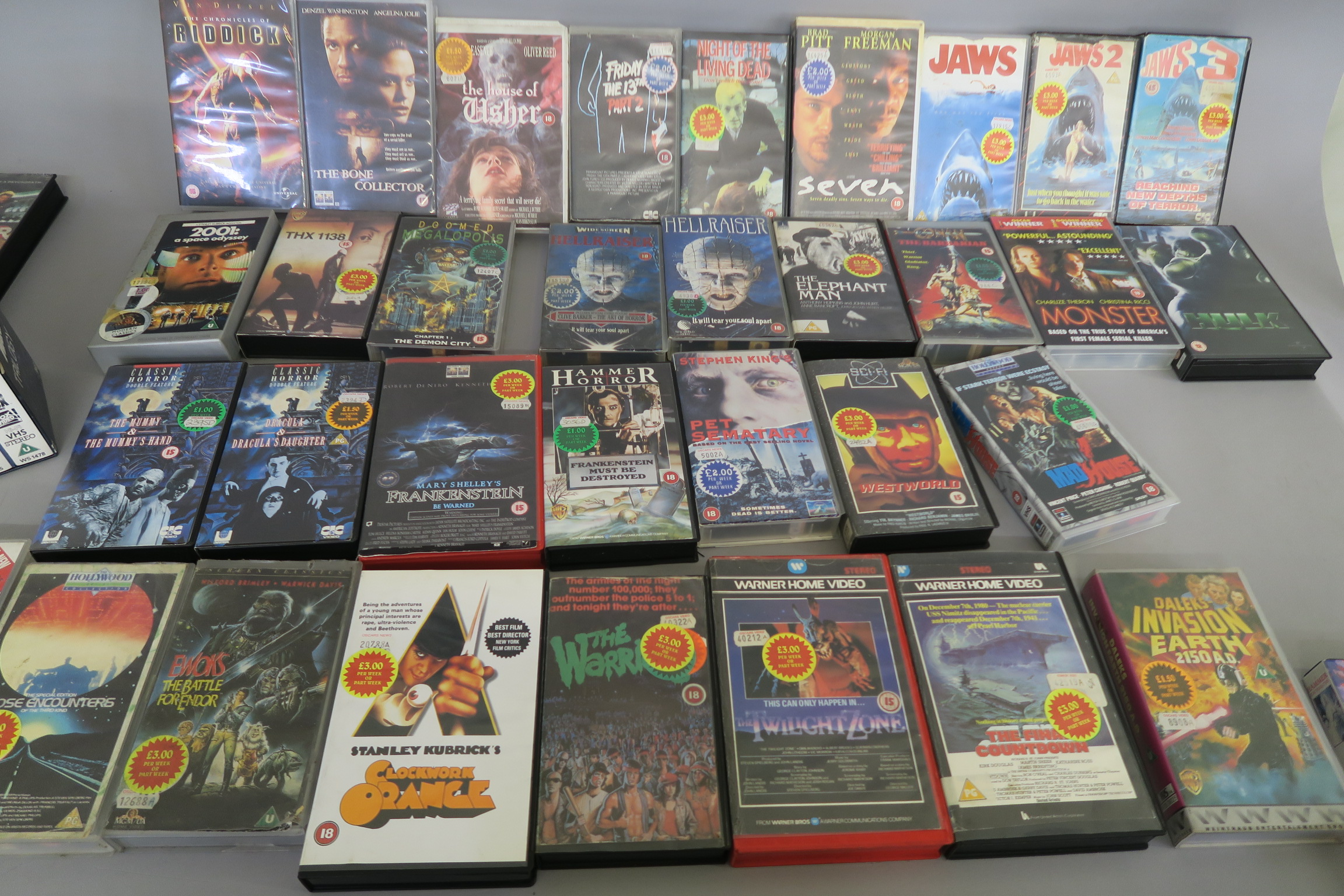 Lot 31 - Horror and Sci Fi video collection directly from a closed video shop in the 1990s and offered for