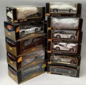 11 assorted Maisto 1/18 scale diecast model cars. All boxed.