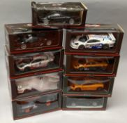 9 UT Models 1/18 scale McLaren diecast model cars. All boxed.