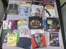 Collection of approx 50+ LPs and concert books. Records include Wings, Fleetwood Mac, Rolling