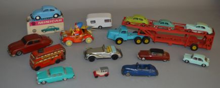 Mixed lot of vintage plastic and tinplate models including Startex Jaguar 2.4, boxed Minicar VW
