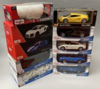 10 assorted Maisto 1/18 scale diecast model cars. All boxed.