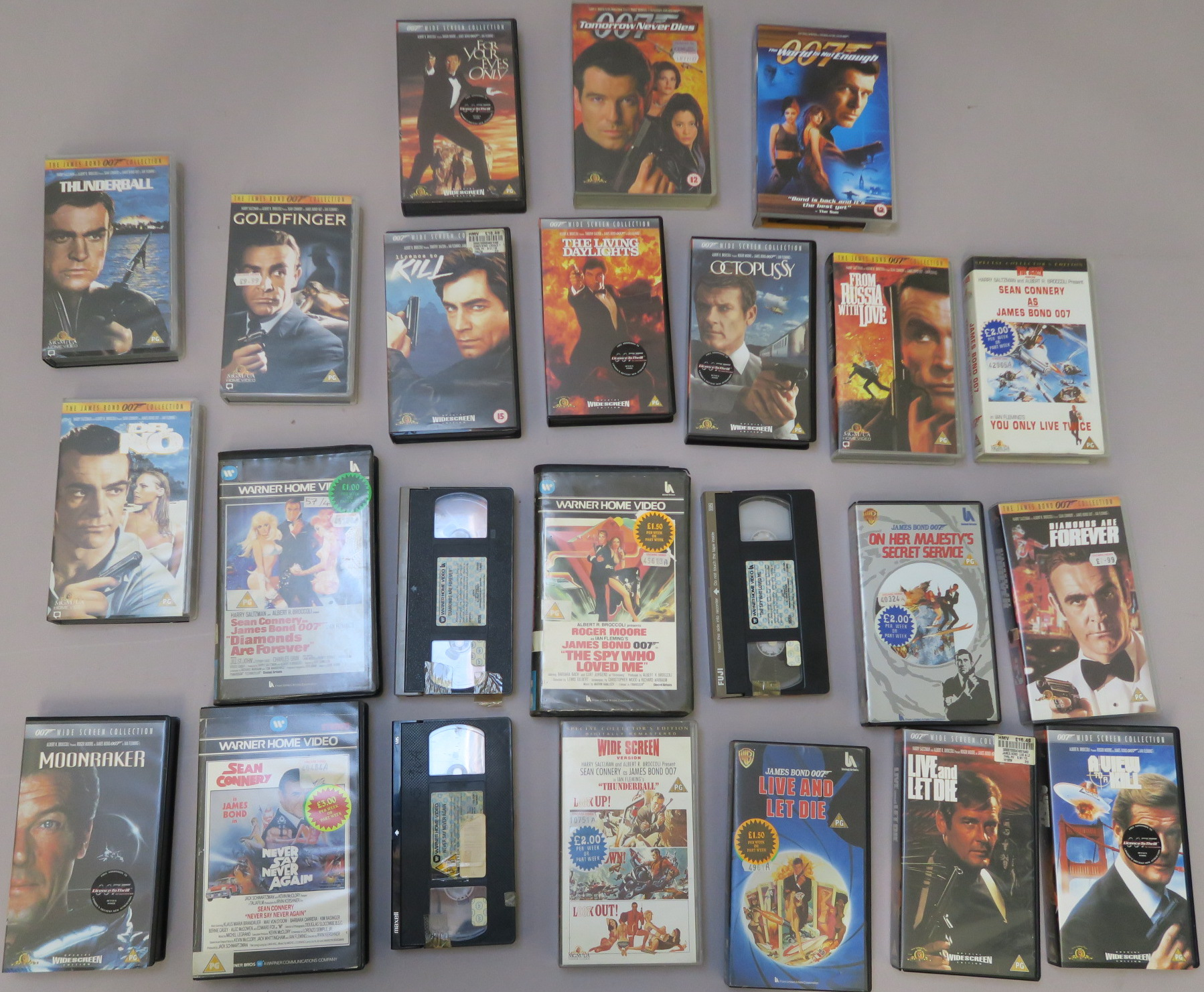 Lot 44 - James Bond collection of VHS videos including first edition Warner home video moulded big box rental