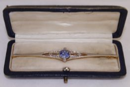 An Edwardian sapphire & diamond brooch tested platinum & 18ct, round sapphire measures approx 8.
