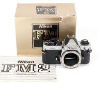 Chrome Nikon FM2n #8410746 (condition 5F) in maker's box.