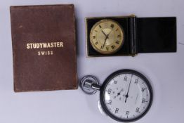 A Jaeger LeCoultre mechanical travelling clock in a black enamelled metal case, together with a