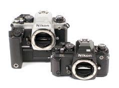 Black Nikon FA Body & A Chrome FA Body with MD-15 Motor.