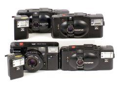 Group of Olympus XA Series Compact Cameras.