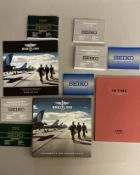 A quantity of watch catalogues & booklets to include Breitling, Oris etc
