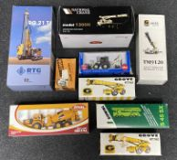 9x Construction vehicle models including National Crane, Grove and RTG examples, all boxed.
