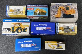 8x Komatsu construction vehicle models by various manufacturers including Joal and NZG, all boxed.