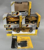 5x CAT construction vehicle models including examples by Norscott and Ertl, all boxed/carded.
