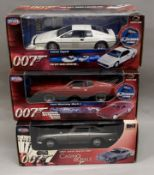 3x James Bond 007 1:18 Scale vehicle models by Joyride: Lotus Esprit, Ford Mustang Mach 1, Aston