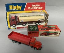 A vintage Tekno 451 Scania- Vabis together with a Dinky 950 Foden Fuel Tanker, both boxed.