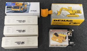 6x Construction vehicle models including Demag and Krupp examples, all boxed.