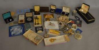 A mixed lot of vintage costume jewellery, medallions, empty jewellery boxes etc.