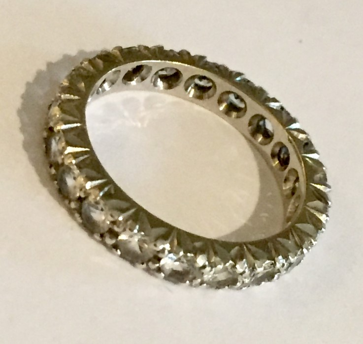 Lot 124 - A 9ct gold diamond and sapphire eternity ring (size N) along with one other (size O)