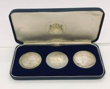 A cased set of hallmarked silver replica Crowns representing the sailing of the Pilgrim Fathers