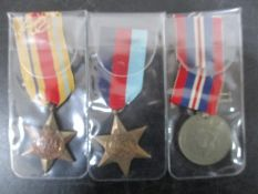 A group of three WWII medals