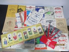 A collection of vintage football programmes, newspaper clippings etc along with an album of