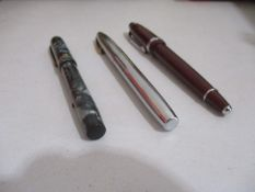 A collection of three fountain pens including Sheaffer, Cross & Conway Stewart