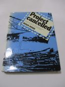 "Hardback ""Project Cancelled"" by Derek Wood. Bound in blue cloth with gold lettering on spine and"