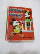 "Hardback ""Mickey Mouse Annual"" by Walt Disney Entertaining. Bound in decorated boards and spine."
