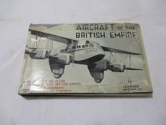 "Hardback ""Aircraft of the British Empire"" by Leonard Bridgman. Bound in dark blue cloth with gold"